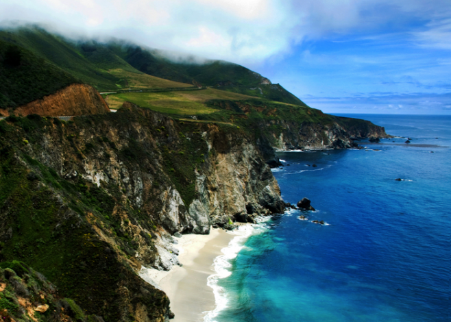 photo of beach and mountain